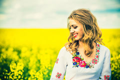 One pretty girl walkin in the yellow field with blue sky Royalty Free Stock Photography