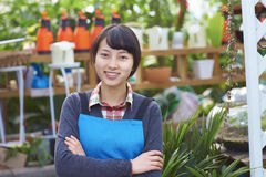 One Pretty Young Asian Florist Working in the Garden Stock Photography