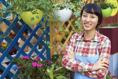 One Pretty Young Asian Florist Working in the Garden Stock Photo