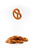 One pretzel flying and few pretzels on a white background Royalty Free Stock Photos