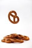 One pretzel flying and few pretzels on a white background Royalty Free Stock Photography