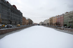 One of the prospects in Saint Petersburg. Colorfull sky. Icy river. snowy day. Old buildings royalty free stock image