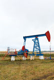 One pump jacks on a oil field. royalty free stock photos