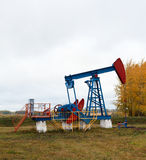 One pump jacks on a oil field. Stock Photo