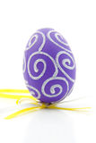 One purple easter egg. Isolated on white background royalty free stock image