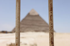 Egyptian Pyramid Behind Bars Stock Images