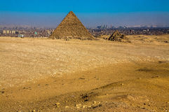 One of the Pyramids of Giza. This is a picture of one of the six pyramids at the Giza Necropolis. With the edge of the Sahara Desert in the foreground Stock Images