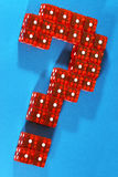 The one question. Question mark made out of red dices on blue background Stock Photography