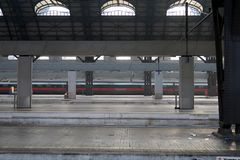 Milan, Central Station. 12/22/2016. The almost empty station is a red arrow train royalty free stock images