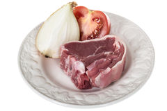One Raw Single Lamb Chop with Tomato and Raw White Onion Royalty Free Stock Photo