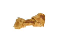One Rawhide Bone for a Dog. Brown natural colored rawhide bone for a dog, isolated on white Royalty Free Stock Photography