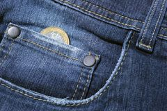 Coin in the pocket of the pants Royalty Free Stock Images