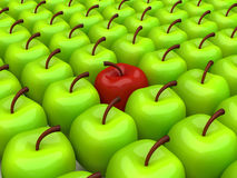 One red apple among background of green apples Stock Images