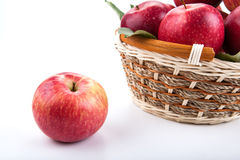 One red apple and basket with apples Stock Photo