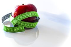 One red apple with green measure royalty free stock photo