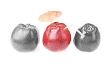 One red apples and two colourless apples. Two colourless red apples and one apple with cocktail tube and umbrella royalty free stock image