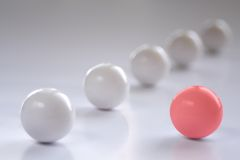 One Red Ball. One red and five white balls Stock Image