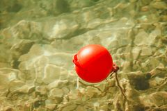 One red ball buoy Stock Photography