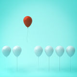 One red balloon different from other white balloons on light green Royalty Free Stock Photo