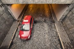 one red blurred passanger car leaves tunnel in Warsaw, Poland, o royalty free stock photo