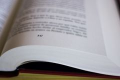 One red book open on a table background royalty free stock image