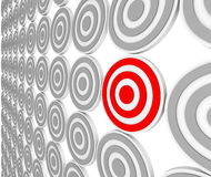 One Red Bulls-Eye Target - Niche Market Audience. Many bulls-eye targets in rows and one in red representing a niche market in a crowded marketplace of Stock Photos