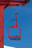 One red chair of ski lift Royalty Free Stock Photo