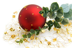 One red christmas ball with golden decoration Stock Images
