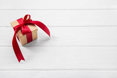 One red christmas present on white wooden background with a big Stock Photos