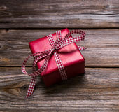 One red christmas present wrapped in red paper with checked ribb Stock Images