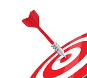 One red dart hitting the center of a target. Stock Image