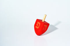 One Red Dreidel (sevivon) spin during the Jewish holiday of Hanu Stock Image