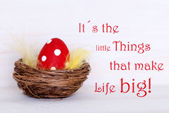 One Red Easter Egg In Nest With Life Quote Little Things Make Life Big Stock Images