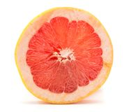Red grapefruit isolated. One red grapefruit ring slice isolated on white background Stock Images