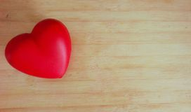 Love. One red heart decor in the left side of wooden horizontal backround stock photos