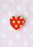 One red heart with pink white dot background Royalty Free Stock Image