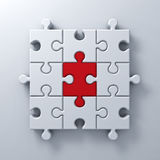 One red jigsaw puzzle piece stand out from the white crowd different concept on white wall background with shadow Royalty Free Stock Photo