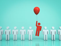 One red man flying upward with red balloon out from other people on light green pastel color Royalty Free Stock Photography
