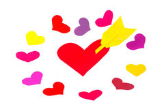 One red paper heart shape with arrow and roundelay. From colored heart shapes Stock Image