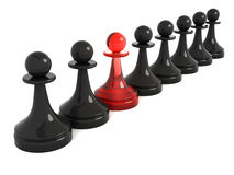 One red pawn in row of black Stock Images