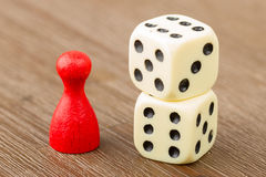 One red pawn and two dice Stock Photo