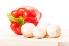 One red pepper and a bunch of mushrooms Royalty Free Stock Photo