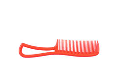 One red plastic comb isolated on white Stock Image
