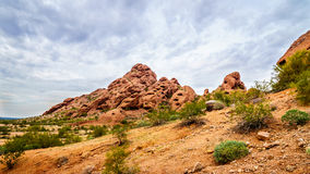 One of the red sandstone buttes of Papago Park near Phoenix Arizona. One of the red sandstone buttes of Papago Park, with its many caves and crevasses caused by Royalty Free Stock Photography