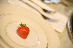 One red strawberry on  plate Stock Photos