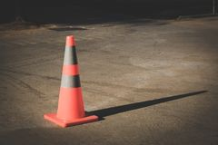 Traffic cone on the road. One red traffic cone on the road Stock Photo