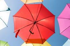 One red umbrella on blue sky Stock Photos