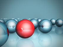 One red unique individual ball in blue group Stock Image