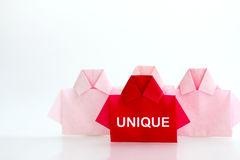 One Red among white origami shirt paper , unique individuality a Royalty Free Stock Photography