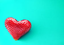 One rich strawberry fruit in form of heart. Stock Photos